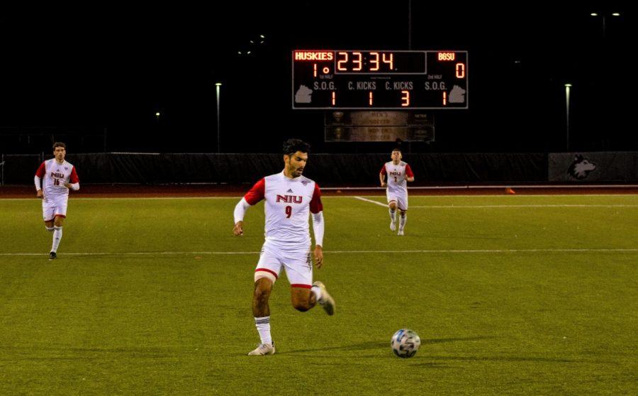 Redshirt junior forward Enrique Banuelos plays the ball during an Oc.t 16 match against Bowling Green.