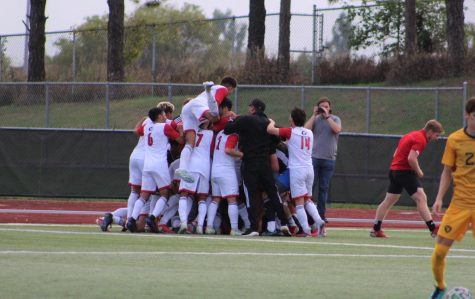 The mens soccer team celebrates after a goal by sophomore midfielder Eddie Knight in the 88th minute sealed a 2-0 win over West Virginia on Oct. 9.