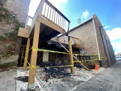 The damage from the back porch of Hometown Sports Bar and Grill is blocked by yellow tape.
