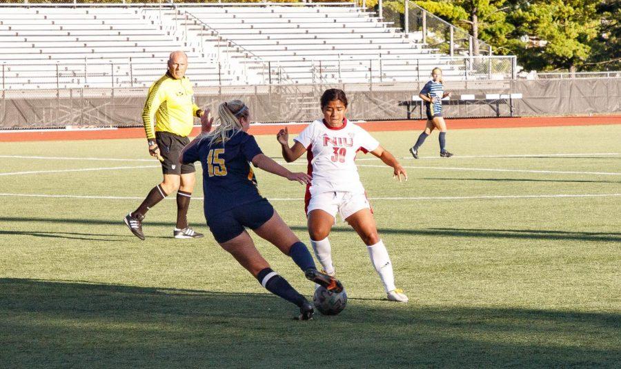 Freshman midfielder/forward Edith Delgado defends a Toledo player during NIUs match on Sept 23.