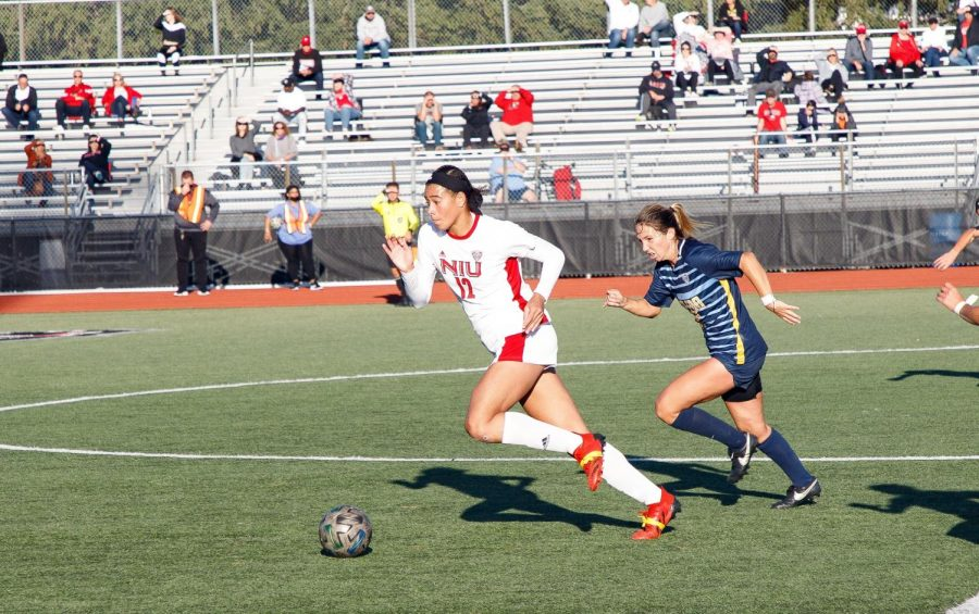 Graduate student forward Haley Hoppe dribbles past a defender during a match on Sept. 23. Hoppe is helping the next generation of womens soccer players while continuing to lead the Huskies offense.