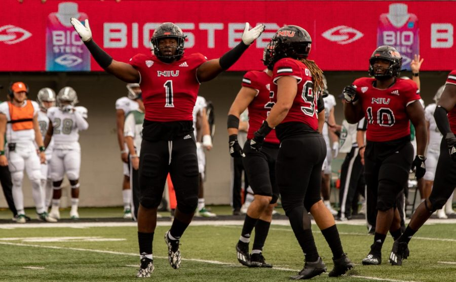 Redshirt+freshman+defensive+end+James+Ester+celebrates+a+sack+in+the+first+quarter+against+EMU+on+Oct.+2.+The+Huskies+beat+EMU+27-20+to+move+to+3-2+overall.