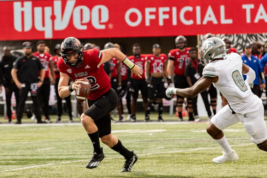 Junior+quarterback+Rocky+Lombardi+evades+a+rusher+during+a+NIU+football+game+against+Eastern+Michigan+on+Oct.+2.+NIU+hosts+Bowling+Green+State+University+on+Saturday.