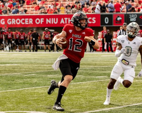 Junior quarterback Rocky Lombardi rushes to the right against EMU at Huskie Stadium on Oct. 2. Lombardi rushed for his fourth touchdown of the season in NIUs 27-20 victory.