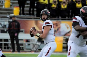 Junior quarterback Rocky Lombardi looks for an open man during NIUs game on Oct. 23 against Central Michigan. Lombardi threw for 320 yards and three touchdowns.